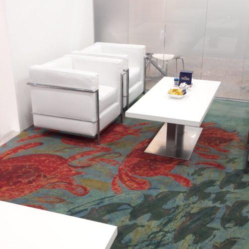 Il riuso del Green Carpet ECONYL® dell'evento di Milano nella stand Aquafil, all'insegna della circolarità.