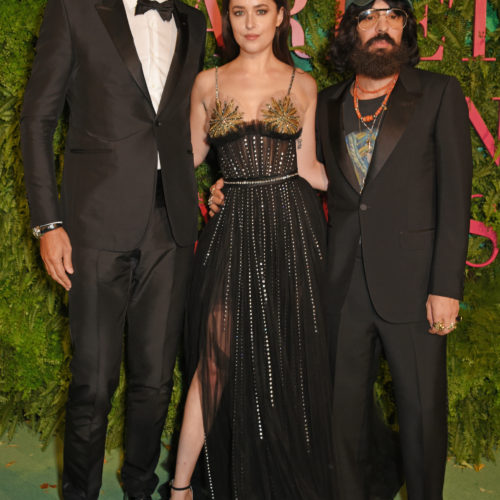 Marco Bizzarri, Gucci President and CEO, Dakota Johnson and Alessandro Michele, Gucci Creative Director, attend the Green Carpet Fashion Awards, Italia.  (Photo by David M. Benett/Dave Benett/Getty Images for Eco-Age)