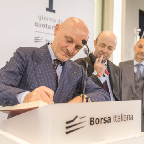Ceo Giulio Bonazzi writing on the IPO book of Borsa Italiana.