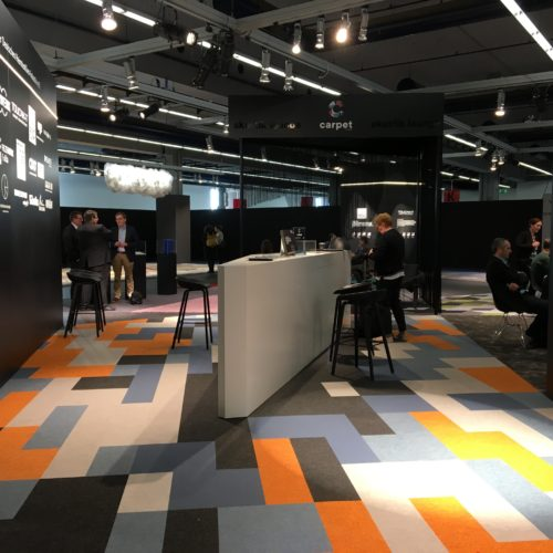 Inside the booth, a spectacular mosaic of creativity on the foor. Some of the carpets were made with ECONYL® yarns.